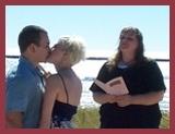 Kya weds a couple on Lake Michigan